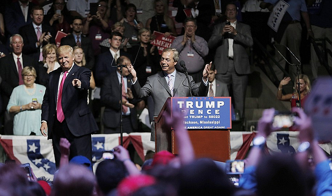 Nigel Farage of British Brexit fame spoke at the Mississippi Coliseum on Aug. 25, 2016, during a rally Donald Trump (left) held in Jackson. Gov. Phil Bryant apparently introduced Trump and Farage before the rally, and has now invited his Brexit friend to attend Trump's inauguration.