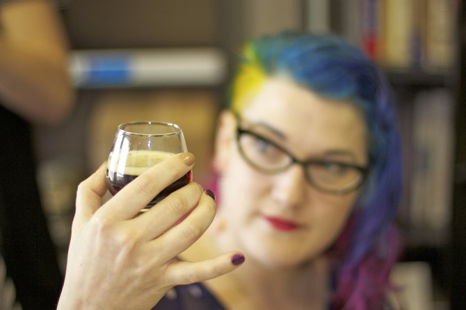 JFP Art Director Kristin Brenemen tries a new craft beer at the JFP vs. Raise Your Pints taste-off this summer.