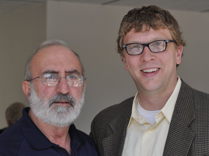 Hank Holmes, left, director of the Mississippi Department of Archives & History, with Robert Luckett, right, the director of the Margaret Walker Center, after his Jackson 2000 presentation on July 11, 2012.