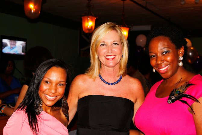 Center for Violence Prevention Director Sandy Middleton (center) enjoys the JFP Chick Ball with two attendees.