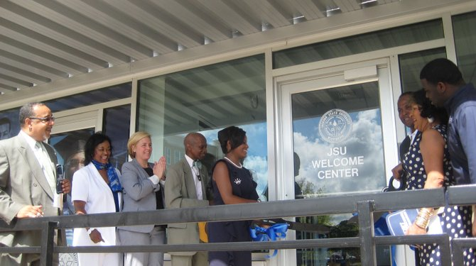 JSU and city leaders open the doors to JSU's new Welcome Center. From left: David Hoard (vice president of institutional advancement), Gwen Caples (director of JSU Welcome Center), Marika Cackett (public relation manager of Jackson Convention and Visitors Bureau), state Sen. Hillman Frazier, Sarah Brown (Miss Jackson State University) and Carolyn W. Meyers (president of Jackson State University)