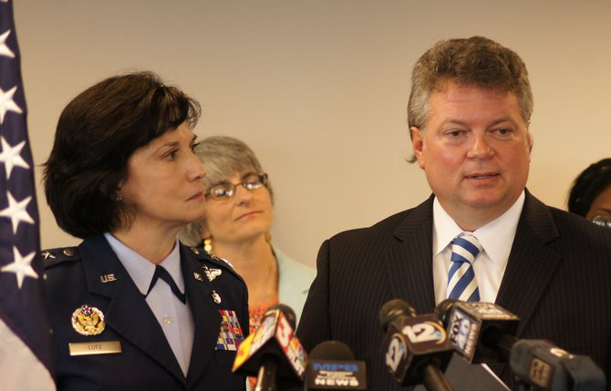 Mississippi Air Guard commander Major General Catherine S. Lutz and, left, and Mississippi Center for Justice advocacy director Beth Orlansky, center, say a new state program will benefit people hurt in the foreclosure crisis.