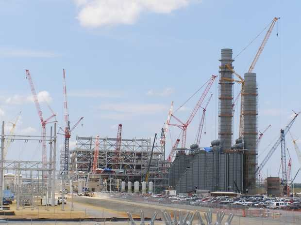 Opponents of Mississippi Power's 582-megawatt generating station in Kemper County question if the company's financial setbacks have resulted in a work slowdown at the plant, under construction since 2010.