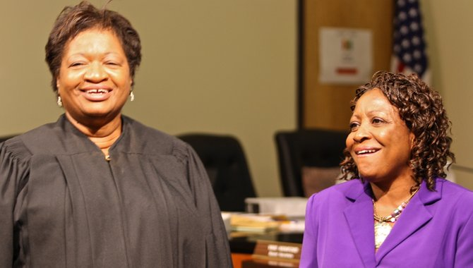 Hinds County Chancery Judge Patricia Wise (left) swore in Beneta Burt (right) to the JPS school board Wednesday.