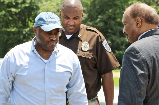 Hinds County Sheriff Tyrone Lewis (left) speaks to Hinds County Supervisor Robert Graham (right), District 1, outside the Hinds County Correctional Facility Monday. Inmates took over at least one housing unit of the jail Monday morning.