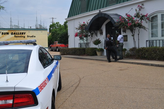 JPD officers stand outside the BankcorpSouth building on N. State Street.
