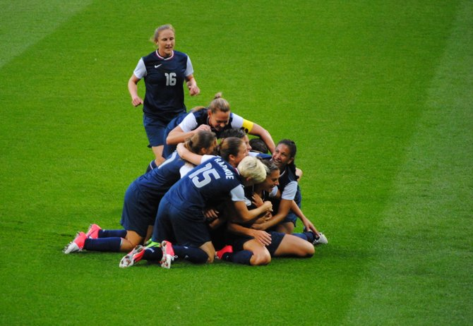 The U.S. Women's soccer team celebrates after defeating Japan 2-1 for the gold.