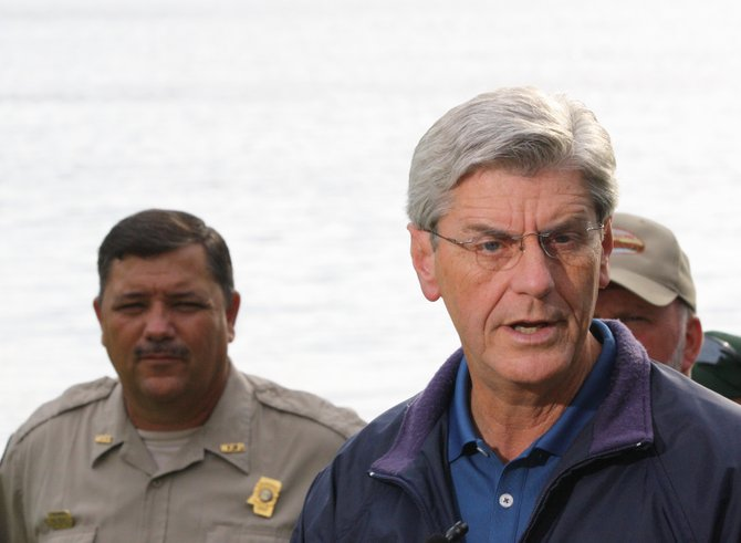 Gov. Phil Bryant toured the dam at Lake Tangipahoa Thursday with engineers and officials from several state departments.