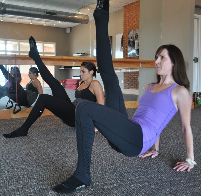 Instructor Katherine Fredericks, left, and Heidi Hogrefe, owner of Pure Barre franchises in Jackson and Ridgeland, demonstrate the hottest new trend in the workout world.