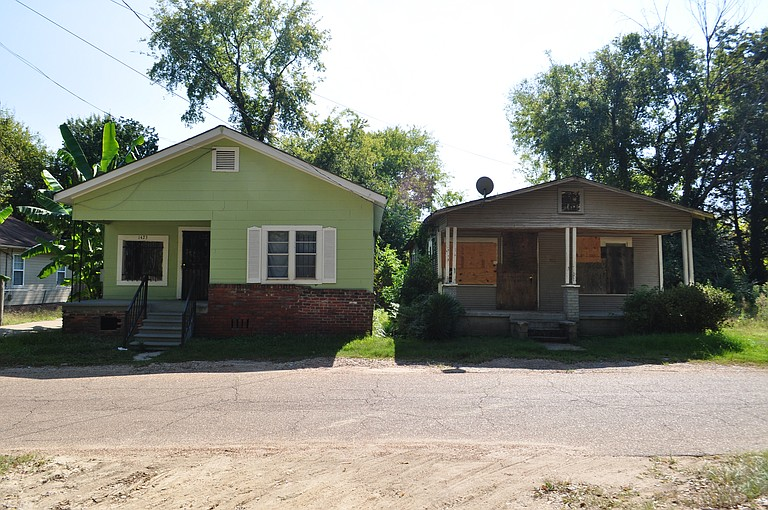 These side by side homes epitomize the challenges and struggles of the Washington Addition neighborhood.