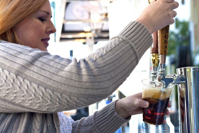 Katie Parkman pours a craft beer at last year&#39;s Jacktoberfest.