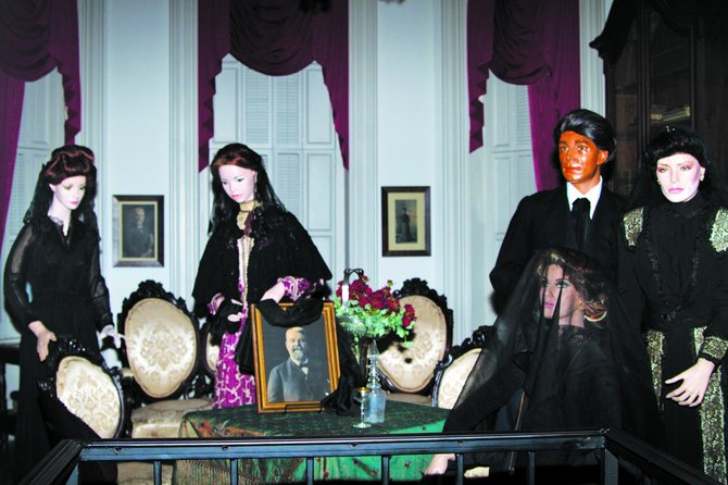 Antique dolls stand vigil in Merrehope Mansion in Meridian.