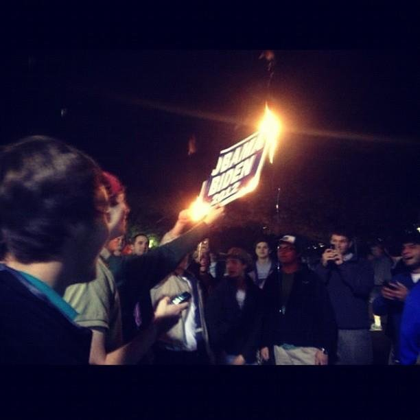 This photo of students at Ole Miss burning an Obama/Biden yard sign in protest of the president&#39;s re-election victory went viral Election night.