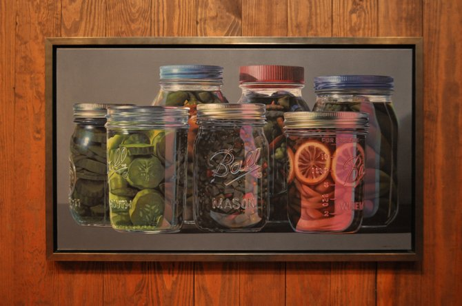 One of Tutor's most popular paintings of mason jars also hangs in the Mississippi Museum of Art.