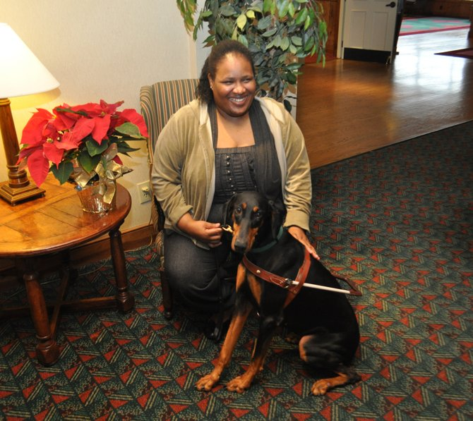Zoey with her owner, Consuelo Johnson