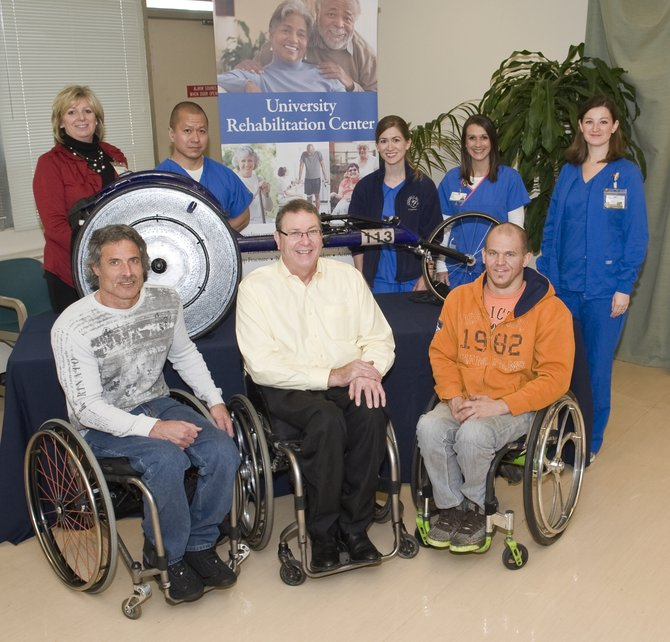 Front from left: Grant Berthiaume of Arizona, Paul Erway of Kentucky and Aaron Roux of Arizona. Standing from left: Shelly Poole, administrator of rehabilitation services at UMMC;  Boon Ong, University Rehabilitation Center physical therapist; Amy Fountain, URC physical therapist; Holly Burney, URC occupational therapist; and Meredith Duncan, URC occupational therapist.