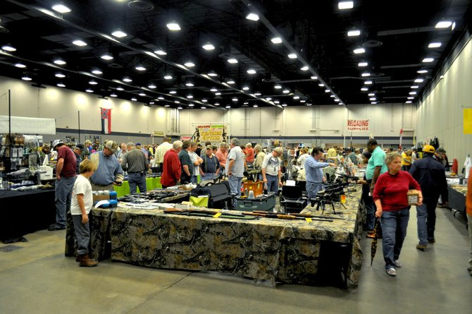 A gun vendor displays his wares to Mississippians at the Jackson Gun Show that took place Jan. 12 and 13 at the Trade Mart Building. Organizers estimated that the turnout hit record numbers; some attendees waited in line for hours just to get in.