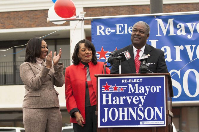 Mayor Harvey Johnson Jr. announced his campaign for reelection Saturday with his wife, Kathy, and daughter, Sharla, at his side.