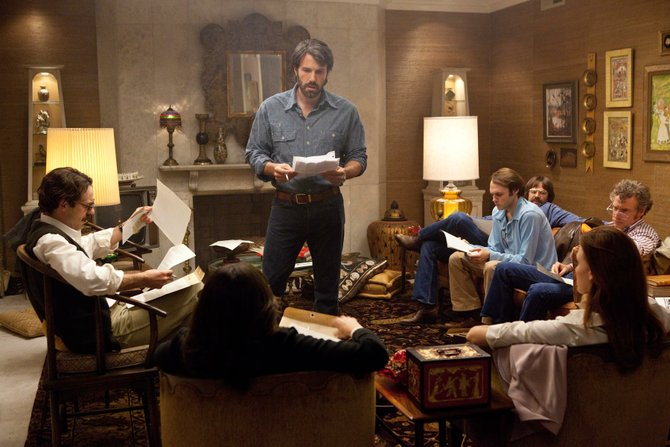 "Ben Affleck (standing) starred in and directed ""Argo,"" which Anita Modak-Truran picks to win Best Picture."