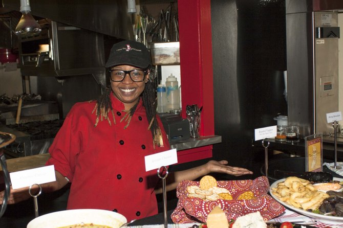 Syrena Johnson, a graduate of Liberty's Kitchen, now works for the non-profit organization full-time.
