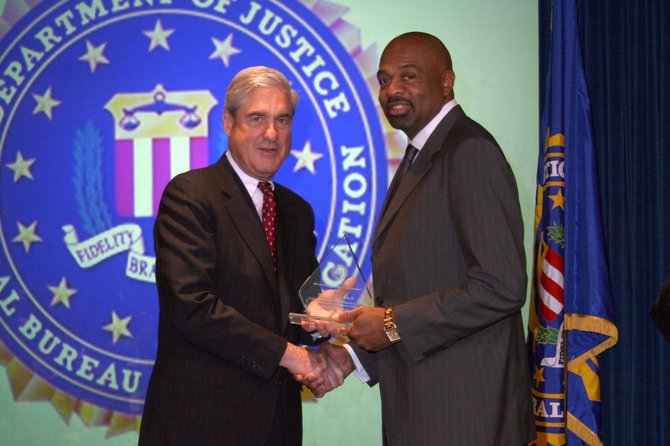 FBI Director Robert S. Mueller III (left) and and James E. Graves Jr. (right)