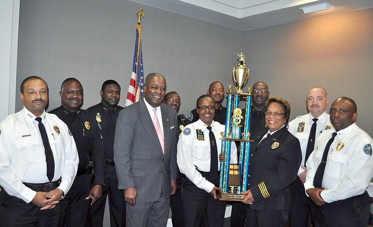 Mayor Harvey Johnson Jr. (fourth from left) and JPD Chief Rebecca Coleman (third from right) recently recognized the efforts of Precinct 1 cops to reduce crime in the first quarter of 2013.