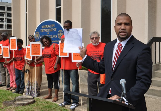 Mississippi SPLC managing attorney Jody Owens (far right) spoke at a press conference in front of MDOC headquarters this morning.
