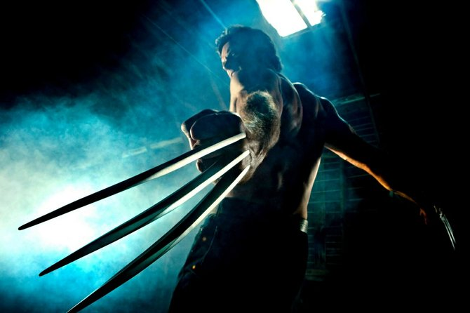 "A buff and hairy Hugh Jackman wields his razor-sharp claws in ""The Wolverine."""