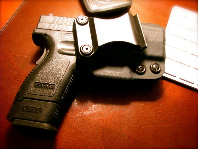 City Council President Charles Tillman has introduced a gun ordinance that would ban handguns from most public places.