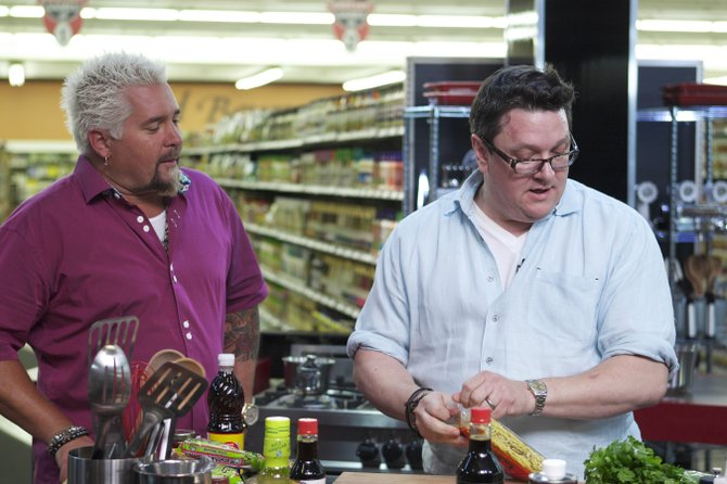 """Local chef and restaurateur Tom Ramsey (right, with host Guy Fieri) will appear on the series premiere of the Food Network show """"Guy's Grocery Games."""""""