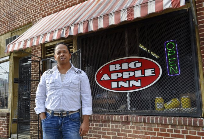 Geno Lee is the fourth generation of his family to sling pig-ear sandwiches at the Big Apple Inn.