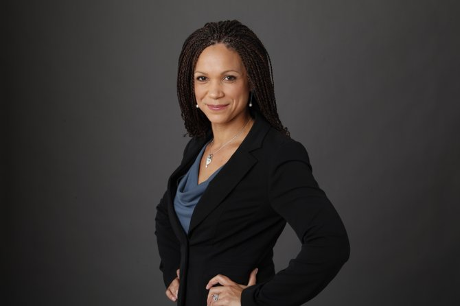 Melissa Harris-Perry apologized after Mitt Romney's family Christmas card, which showed the Republican's adopted, African-American grandson, was joked about on her show. She said she meant to praise the family's inclusion, but the message went awry with her panelists' sarcasm.