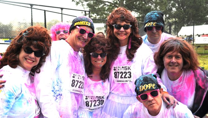 The Color Me Rad 5K and 3.21 Run Up for Downs kick off spring race season. Pictured are Boss Queen Jill Conner Browne and other Sweet Potato Queens participating in Color Me Rad last year.