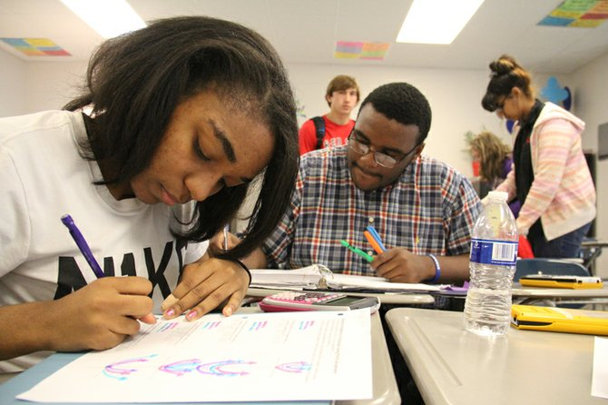 Students in Molly Berry's algebra class in Tate County work on an assignment together. When the state took control of the district in 2009, the pass rate on the high school algebra exit exam was only 45 percent.