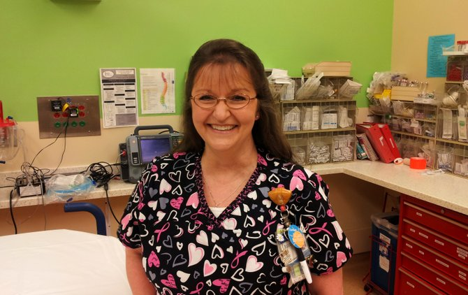 "Peggy ""Denise"" Adams, an emergency-room nurse at Blair E. Batson Hospital for Children, received University of Mississippi Medical Center's 2014 Nursing Excellence Award in May."