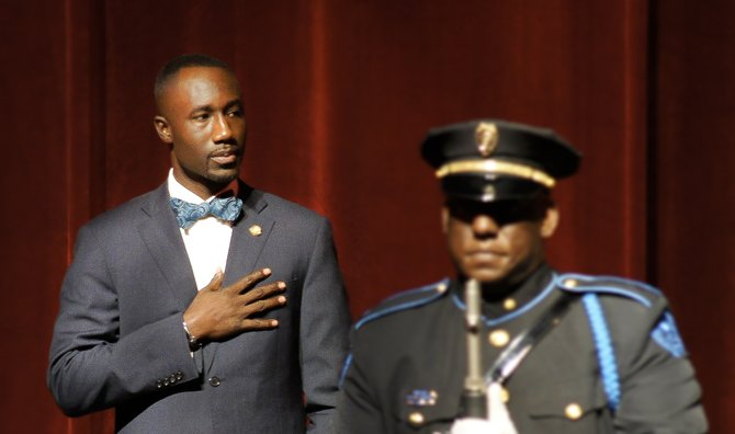 Mayor Tony Yarber and a member of the JPD Color Guard during the Pledge of Allegiance