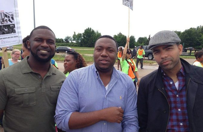 Tyson Jackson, C.J. Lawrence and Chokwe Antar Lumumba stand together at a Lumumba campaign event.