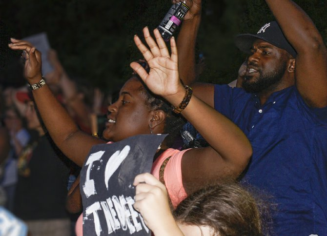 Brittany Gray and Tyson Jackson, Jackson-area community activists, joined attorney C.J. Lawrence (not pictured) on a trip to Ferguson, Mo., over the weekend. They participated in a number of demonstrations in the case of unarmed black teenager Mike Brown, whom Ferguson police officer Darren Wilson shot and killed on Aug. 9.