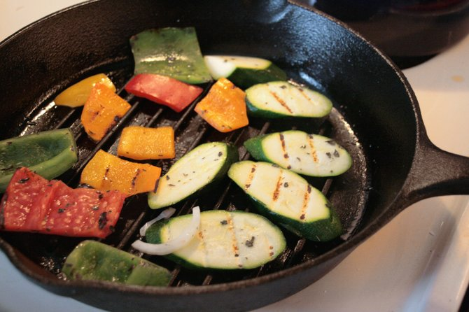 Cast-iron pans are handy for grilling indoors when it gets cooler outside.