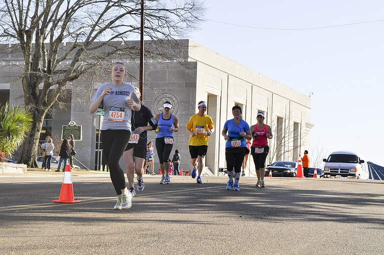 Runners participate in the 2014 Mississippi Blues Marathon.