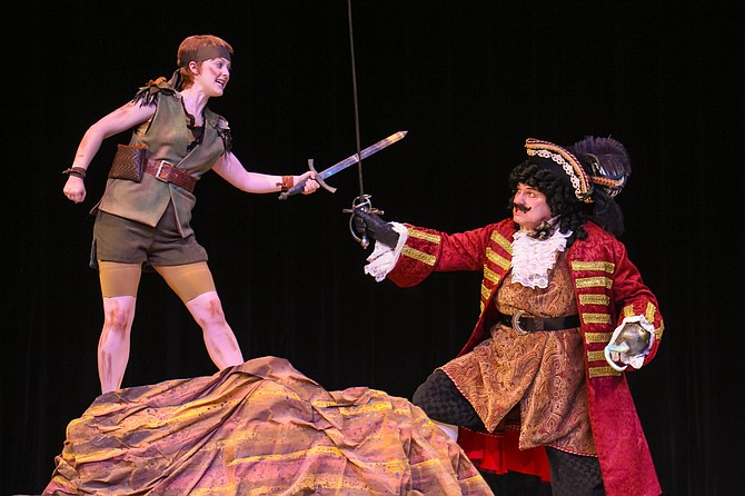 "Peter Pan (Katie Emerson) and Captain Hook (David Spencer) sword fight in New Stage Theatre's production of ""Peter Pan."" Photo courtesy New Stage Theatre"