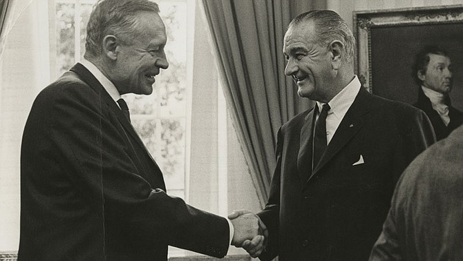 Fifty years ago this this month President Johnson's science advisors delivered the first warning about rising greenhouse gas emissions to a sitting president. On Feb. 8, he warned Congress about altering the atmosphere with carbon emissions. Climate scientist Roger Revelle (left) shakes hands with Johnson (right) in the Oval Office. Photo courtesy Roger Revelle Papers, Special Collections & Archives, University of California, San Diego