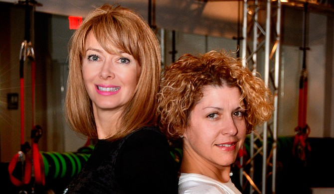 Guruz Fitness Studio, owned by Lacee Chagnon (left), helped Denise Moulier (right) grasp the concept of high-peformance living.