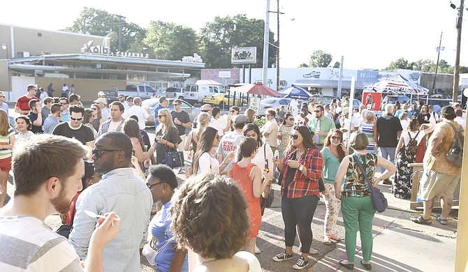 The Fondren neighborhood, which hosts events like Fondren's First Thursday (pictured), could soon be home to a new hotel and manufacturing facility.