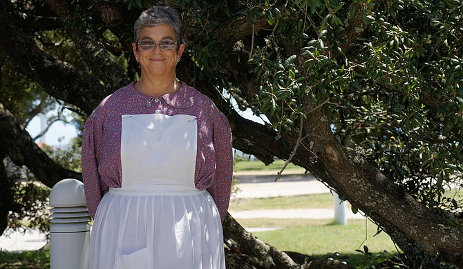 Kitsaa Stevens, who coordinates events at Jefferson Davis's last home, Beauvoir, filed the initial paperwork for Ballot Initiative 54, a petition to keep the 1894 state flag, which she believes is a symbol of reconciliation, not race division.