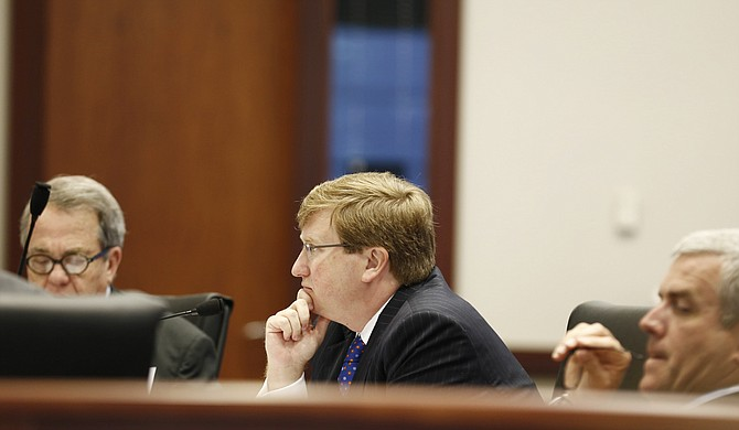Leaked emails claim that Lt. Gov. Tate Reeves (center) and Speaker Philip Gunn (right) are connected to an anti-42 PAC and raise questions about the legality of using taxpayer resources to campaign against a ballot initiative. Senate Pro Tem Giles Ward, R-Louisville, is on the left side of the photo.
