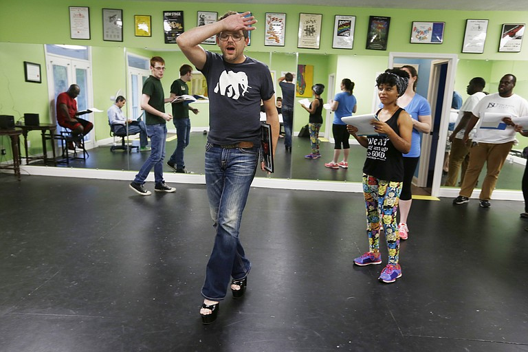 "Chad King, who plays Frank N. Furter in Fondren Theatre Workshop's production of ""The Rocky Horror Show,"" rehearses for the performance as other cast members look on."