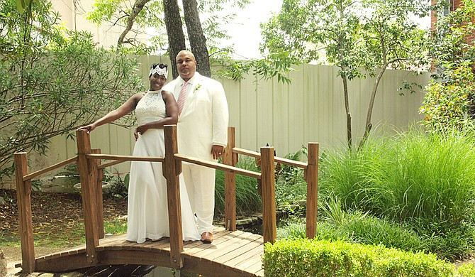 Lakeisha Marie Stewart (then Lakeisha Marie Alexander) married Walter Stewart Jr. in July 2015. Photo courtesy Zachary Robinson