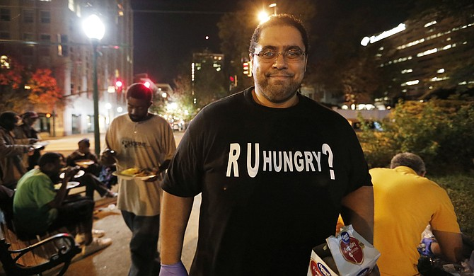 Bilal Qizilbash, 29, pulls together a group of volunteers to provide hot meals to homeless people every Friday at Smith Park.