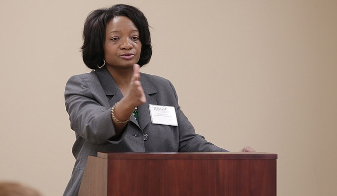 Ta'Shia Gordon, a deputy director with the Mississippi Administrative Office of the Courts, speaks at the Mississippi Working Interdisciplinary Networks of Guardianship Stakeholders Committee at the Mississippi Supreme Court on Dec. 11.
